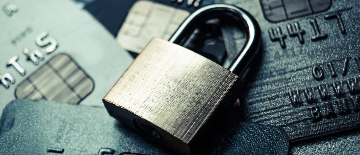 a security lock on credit cards - credit card data encryption concept